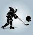 Silhouette of a hockey player with puck vector image vector image