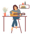 girl playing guitar in room hoband home vector image vector image