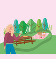 woman with table food blanket forest camping vector image vector image