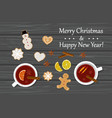 two cups of mulled wine and gingirbread on table vector image