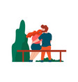 young man and woman sitting on bench in park vector image vector image