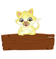 A yellow cat above the empty signboard vector image vector image