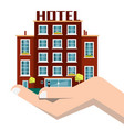 Hotel building icon in human hand isolated on