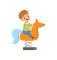 boy riding spring horse see saw kid having fun on vector image
