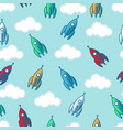 seamless rockets clouds pattern vector image
