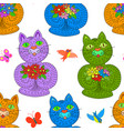multicolored cats with flowers seamless pattern vector image