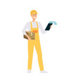loader in overalls holding brown box and checking vector image vector image