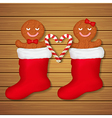 loving couple of gingerbread cookies in red socks vector image vector image