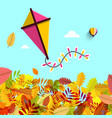 autumn leaves with kite on blue sky fall vector image
