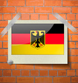 Flags Germany scotch taped to a red brick wall vector image