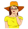 woman looks through sunglasses comic book style vector image