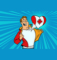 canada patriot male sports fan flag heart vector image vector image