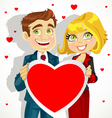 Cute man and woman holding a valentine vector image vector image