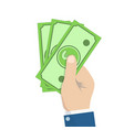 hand holding money cash bills in hand payment vector image vector image