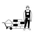 builder man wheelbarrow cement and brick wall vector image vector image