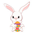 cute bunny sitting with colorful eggs vector image