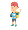 schoolboy holding a book and waving his hand vector image vector image