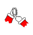 hand of santa claus holding mobile smart phone vector image vector image