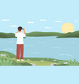 a young man standing on shore vector image vector image
