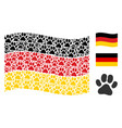 waving german flag mosaic of paw footprint items vector image