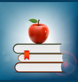 red apple lying on a pile of books vector image