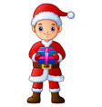 cartoon boy in a santa claus costume holding gift vector image vector image