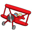 flying red biplane vector image