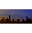 silhouette of town with sunset and clouds in sky vector image vector image