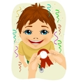 hands pins award ribbon to chest of little boy vector image vector image
