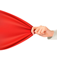 Hand tugging a red cloth with space for text vector image