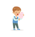 cartoon cheerful boy eating sweet cotton candy on vector image