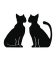 silhouette of two cats vector image vector image