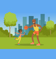 father playing ball with his son in city park vector image vector image
