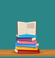pile of different color books on shelf vector image vector image