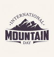 vintage amblem letter international mountain day vector image vector image