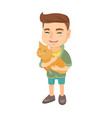 caucasian happy boy holding a cat vector image vector image