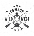 wild west badge with indian arrow and lantern vector image vector image