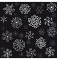 A set of white snowflakes on a black background vector image