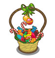 christmas basket with candies lollipops and balls vector image