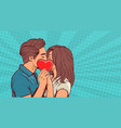 young couple kissing hollding red heart shape over vector image vector image