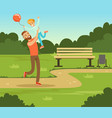boy playing with his father in summer park outside vector image