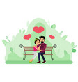 couple in love sitting on bench hugging