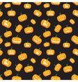 seamless black background with pumpkins vector image