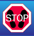 stop sign on a with footprints from shoes vector image vector image