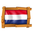 flag of netherland in wooden frame vector image vector image