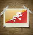 Flags of Bhutan at frame on wooden texture vector image vector image