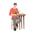 man reads book in cafe coffee cup on table vector image