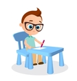 Young boy with glasses paints sitting at a school vector image vector image