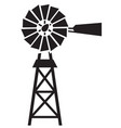 silhouette a water pumping windmill vector image