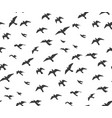 a flock of flying birds gray silhouette dove vector image